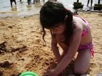 Kyoko playing sand at falls lake.jpg