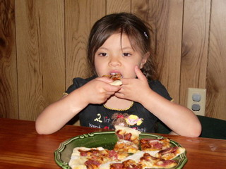 Pizza Day! Ayumi eating Pizza.jpg