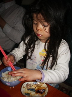 home-made gyoza kyoko eating.jpg